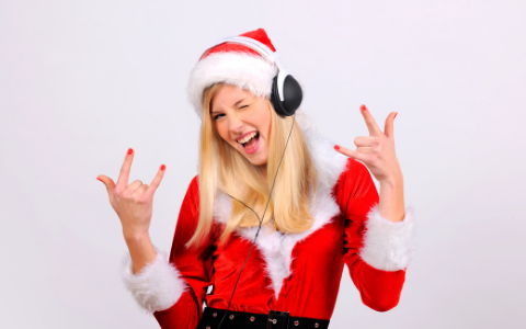 girl in santa hat and head phones
