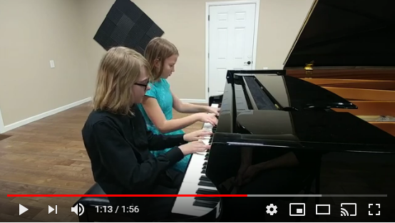 Children Playing the Piano for Competition