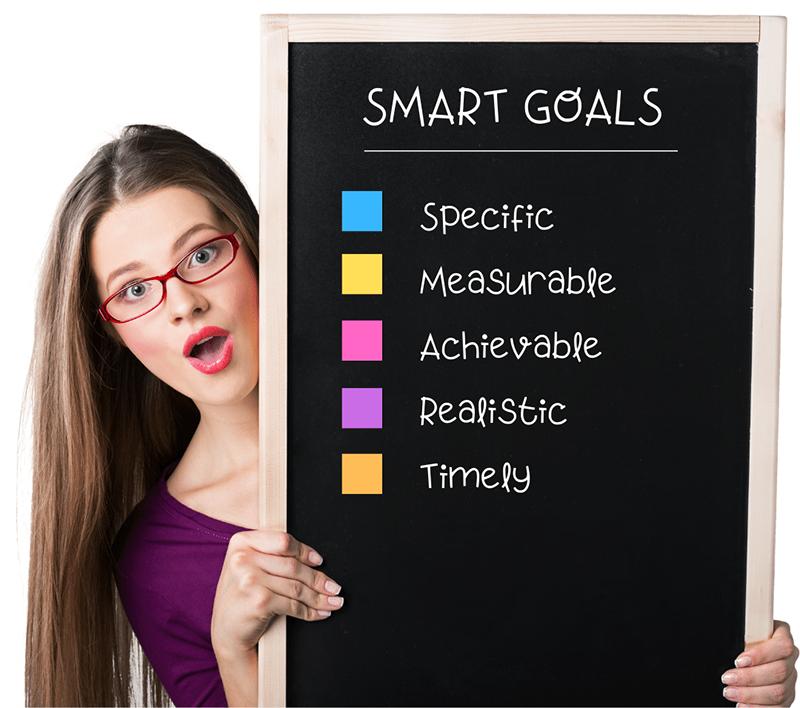 Girl holding Smart Goal chart