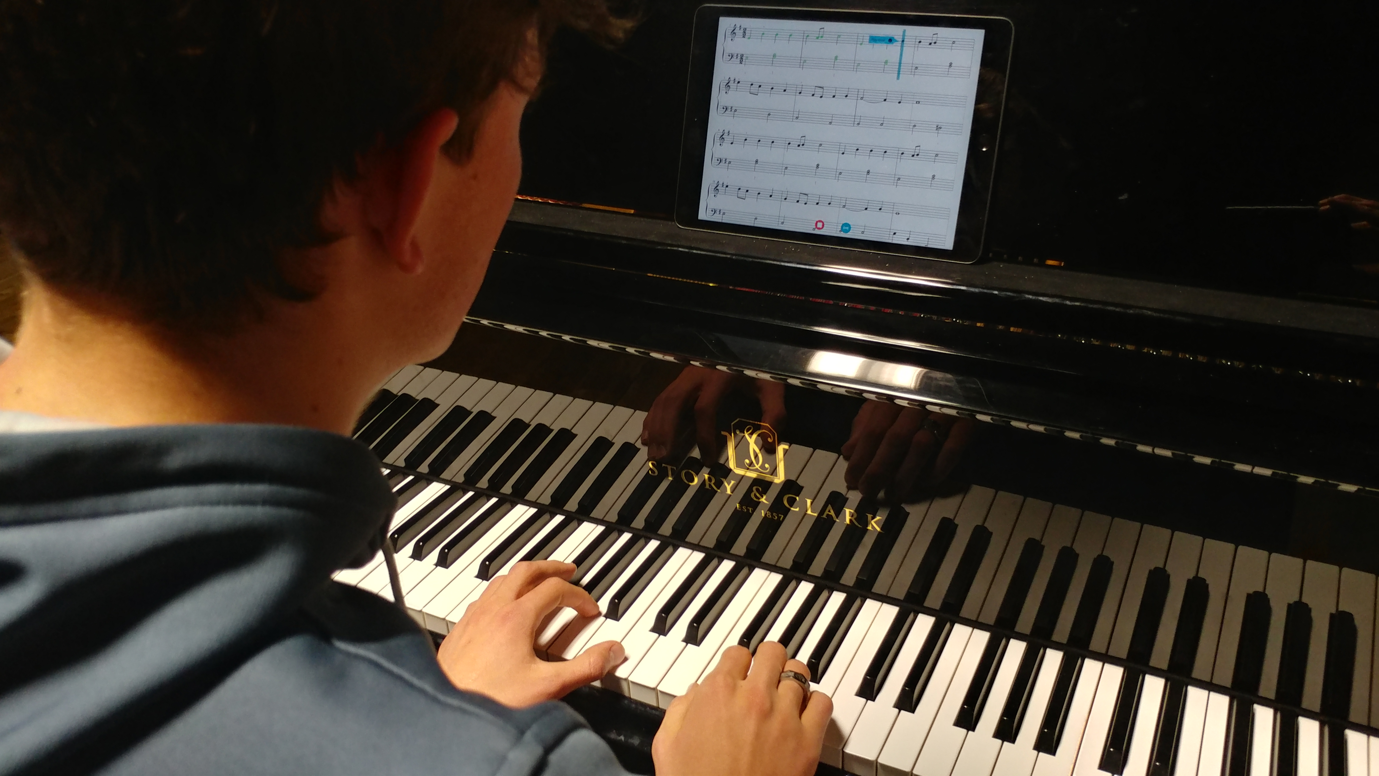 teenage boy playing piano with Piano Marvel